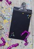 Confetti масленицы на деревянной предпосылке Стоковое Изображение RF