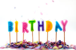 Confetti and birthday candles isolated on white Royalty Free Stock Photography