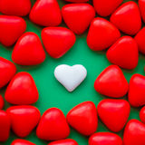 Confetti candies bon bons with the shape of a heart. Many red confetti candies bon bons with the shape of a heart for Valentine's day royalty free stock image