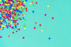 Confetti carnival decoration blue paper background. Confetti carnival decoration on blue paper background royalty free stock photos