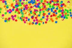 Confetti carnival decoration red green blue yellow background. Confetti carnival decoration red green blue on yellow background stock images