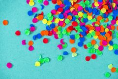 Confetti carnival decoration red green yellow blue background. Confetti carnival decoration red green yellow on blue background royalty free stock photography