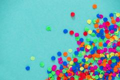 Confetti carnival decoration red green yellow blue paper background. Confetti carnival decoration red green yellow on blue paper background royalty free stock photography