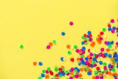 Confetti carnival decoration yellow background. Confetti carnival decoration on yellow background stock photo