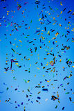 Confetti celebration. Multi-colored confetti in the blue sky stock photography