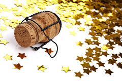 Confetti and champagne cork Royalty Free Stock Image
