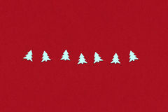 Confetti in christmas tree form on a red Stock Images