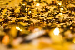 Confetti. Close up of golden shiny confetti pieces stock photography
