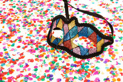 Confetti and a colorful carnival mask Royalty Free Stock Images
