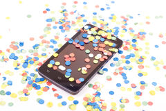 Confetti. Colorful confetti over the mobile phone Royalty Free Stock Image