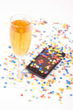 Confetti. Colorful confetti over the mobile phone Royalty Free Stock Photography