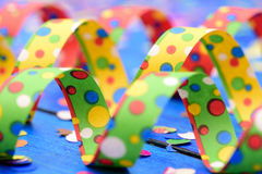 Confetti and colorful paper streamer at carnival Royalty Free Stock Photo
