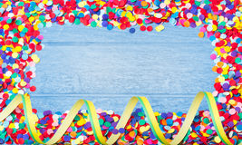 Confetti, colorful and round, on wood Royalty Free Stock Image