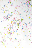 Confetti. Colourful sparlking confetti on white background royalty free stock images