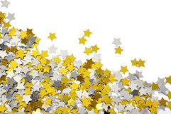 Confetti dourado e de prata da estrela Fotos de Stock Royalty Free