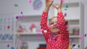 Confetti falling on cheerful girl, birthday celebration, entertainment center. Stock footage stock footage