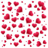 Confetti falling from red hearts Stock Images