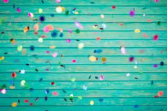 Confetti falling on wooden background. Happy New Year! Confetti falling on wooden background Stock Photo