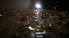 Confetti falls on the floor covered with confetti.  stock footage