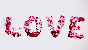 Confetti flying in a gale. On white background stock video footage