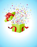 Confetti flying from gift box Stock Photo