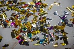 Confetti folia na ceramicznej podłoga Fotografia Royalty Free