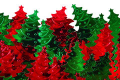 Confetti in the form of Christmas trees Stock Photos