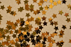 Confetti in the form of gold stars Royalty Free Stock Photos
