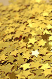 Confetti in the form of gold stars Royalty Free Stock Images