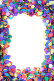 Confetti frame, background. Scattered confetti frame, background with copy space Royalty Free Stock Photography