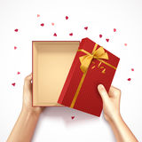 Confetti Gift Box Composition. Hands holding gift box top view realistic 3D background with red rectangular box golden bow and confetti vector illustration Stock Photography