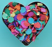 A confetti heart. A baking tin filled with confetti Royalty Free Stock Photography