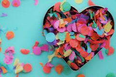 Valentines day, heart with confetti. Creative colorful love concept, carnival background and copy space Royalty Free Stock Photos