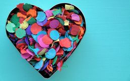 A confetti heart. A baking tin filled with confetti Stock Photography