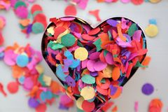 Valentines day, heart with confetti. Love or carnival background and colorful concept Royalty Free Stock Image