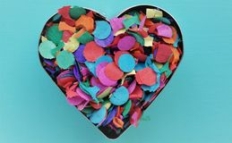 A confetti heart. A baking tin filled with confetti Royalty Free Stock Image