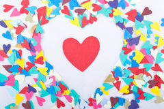 Confetti Heart of Hearts. Paper confetti shaped like hearts arranged into the shape of a heart on a white background Royalty Free Stock Photos