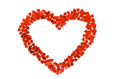 Confetti by hearts in the form of heart. Isolated on white background. stock photos