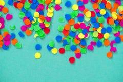 Confetti holidays decoration blue background. Confetti holidays decoration on blue background royalty free stock image