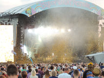 Confetti at the Isle of Wight Festival. Streams of gold coloured confetti paper form part of the light show on the Main Stage at the Isle of Wight Festival in Stock Image