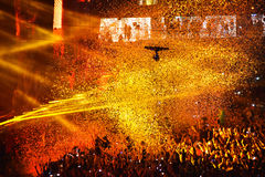 Confetti over partying crowd during a live concert. CLUJ-NAPOCA, ROMANIA - AUGUST 7, 2016: Confetti cannons throwing confetti from the stage over the crowd at a royalty free stock photos