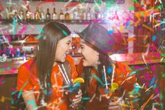 Confetti party. Two young girls lesbians at a party in the club.  royalty free stock images