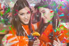 Confetti party. Two young girls lesbians at a party in the club take a selfie.  royalty free stock photography