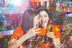 Confetti party. Two young girls lesbians at a party in the club take a selfie stock photos