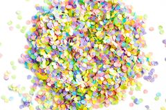 Frame made of colored confetti. Confetti scattered in different colors on a white background. Festive confetti. The decor for the party Royalty Free Stock Images