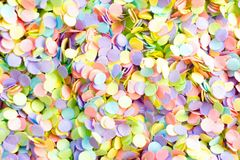 Frame made of colored confetti. Confetti scattered in different colors on a white background. Festive confetti. The decor for the party Stock Photos