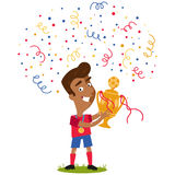 Confetti and streamers showering victorious cartoon footballer holding football trophy Stock Photo
