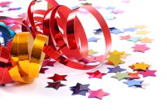Confetti  with streamers on white Royalty Free Stock Photo