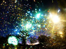 Confetti throw. During the Cape Town Carnival, the organisation threw a big quantity of confetti in the direction of the sky Royalty Free Stock Image