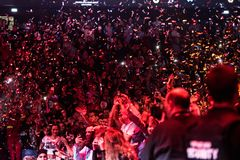 Confetti throwing over partying crowd. CLUJ NAPOCA, ROMANIA - NOVEMBER 19, 2017: Confetti throwing over partying and dancing crowd during the We Love Retro Disco Stock Photos
